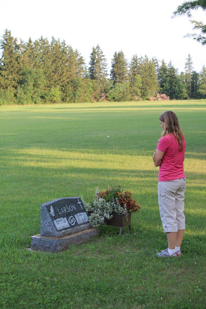 Doris standing by her Dad's grave
