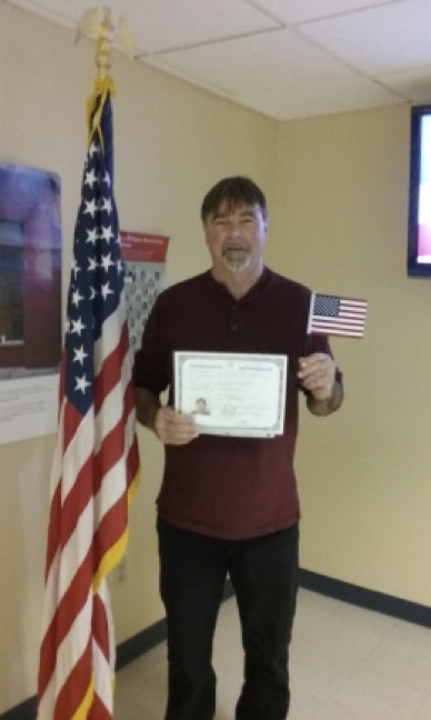 Andy holding his United States Citizenship Certificate.