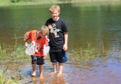 Camping-Boys catching minnows2